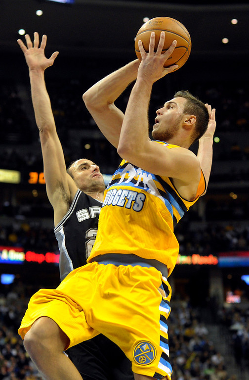 . Denver forward Danilo Gallinario (8) drove to the basket past Spurs defender Manu Ginobili (20) in the second half. The Denver Nuggets defeated the San Antonio Spurs 112-106 at the Pepsi Center Tuesday night, December 18, 2012. Karl Gehring/The Denver Post