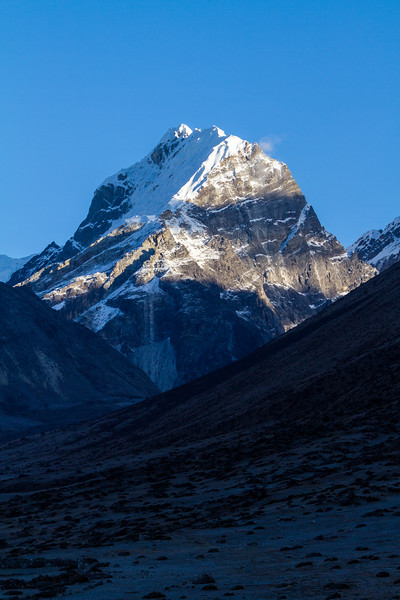 Stark Himalaya Mountains float majestically above the landscape