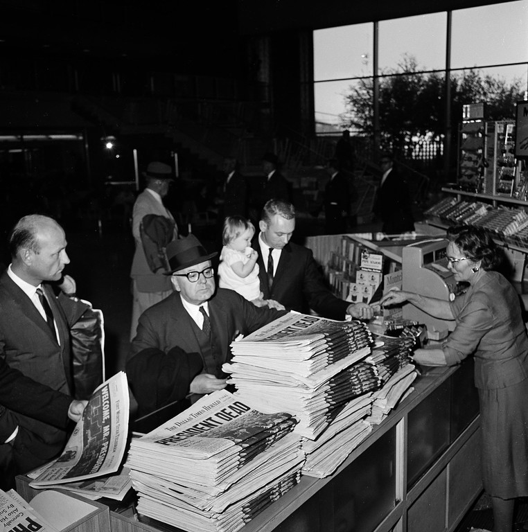 . Stacks of the Dallas Times Herald\'s final edition of the day line a shop counter on Nov. 22, 1963.  Associated Press file