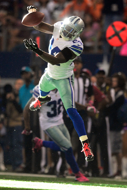 . ARLINGTON, TX - OCTOBER 6: Morris Claiborne (24) of the Dallas Cowboys intercepts a ball thrown by Peyton Manning (18) of the Denver Broncos intended for Eric Decker (87) during the second half of the Broncos\' 51-48 win at AT&T Stadium. The interception is the first of the year thrown by Manning. (Photo by AAron Ontiveroz/The Denver Post)