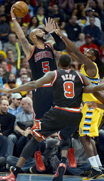 . Chicago Bulls power forward Carlos Boozer (5) takes a shot over Denver Nuggets power forward Kenneth Faried (35) during the first quarter November 21, 2013 at Pepsi Center. (Photo by John Leyba/The Denver Post)
