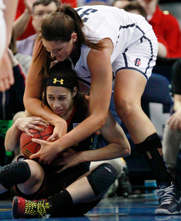 . Maryland guard Chloe Pavlech, bottom, tries to keep a grip on the ball against Connecticut center Stefanie Dolson, top, during the first half of an NCAA women\'s college regional semifinal basketball game in Bridgeport, Conn., Saturday, March 30, 2013. (AP Photo/Charles Krupa)
