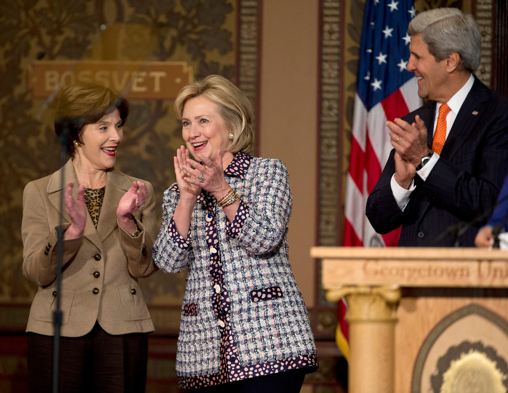 ". From left, former first lady Laura Bush, former Secretary of State Hillary Rodham Clinton, and Secretary of State John Kerry applaud on stage at Gaston Hall at Georgetown University in Washington, Friday, Nov. 15, 2013, during the ""Advance Afghan Women\"" symposium. (AP Photo/Carolyn Kaster)"
