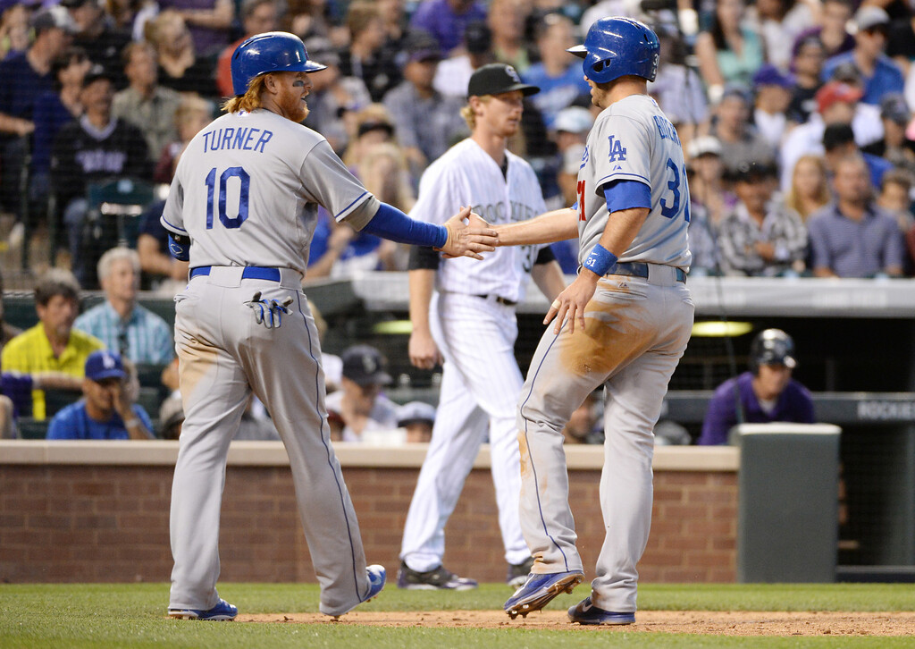 . DENVER JUNE 06:  Justin Turner (10) and Drew Butera (31) of Los Angeles Dodgers celebrate Butera\'s scoring by Eddie Butler of Colorado Rockies (31), center, in the 6th inning of the game at Coors Field in Denver, Colorado June 6, 2014. (Photo by Hyoung Chang/The Denver Post)
