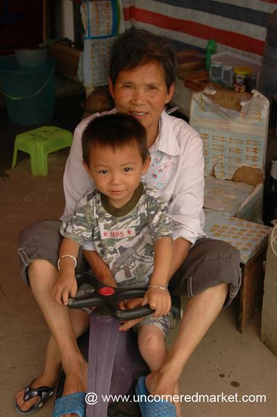 Chinese Grandmother and Grandson - Xishuangbanna, China
