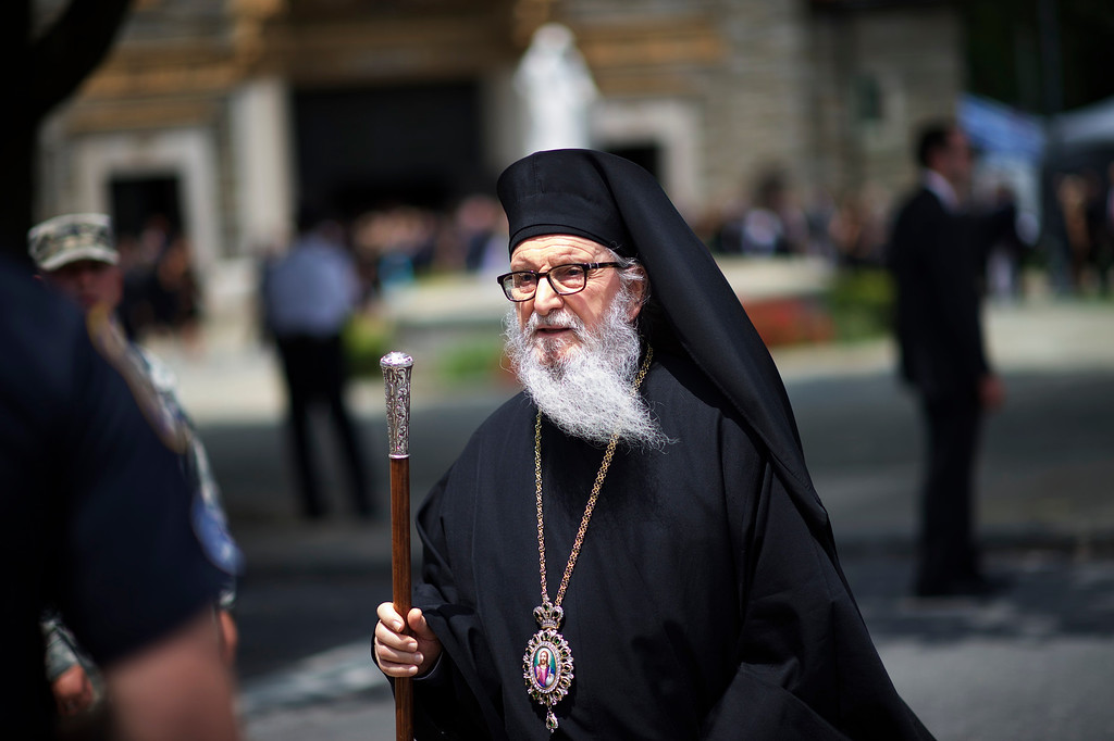 . A member of the clergy exits St. Anthony of Padua Church after a mass of Christian burial was held for former Delaware Attorney General Beau Biden on June 6, 2015 in Wilmington, Delaware. U.S. President Barack Obama delivered a eulogy for the son of Vice President Joe Biden after he died at 46 following a two-year battle with brain cancer.  (Photo by Mark Makela/Getty Images)