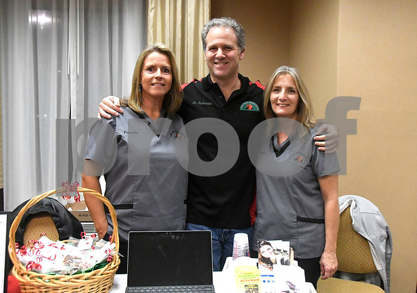 11/29/2017 Mike Orazzi | Staff Dr. Eric Rothstein (center) with Francine Syskowski and Karen Zawisza of Apple Valley Veterinarians during the Southington Chamber of Commerce New Member Showcase held at Comfort Suites Southington Wednesday evening.
