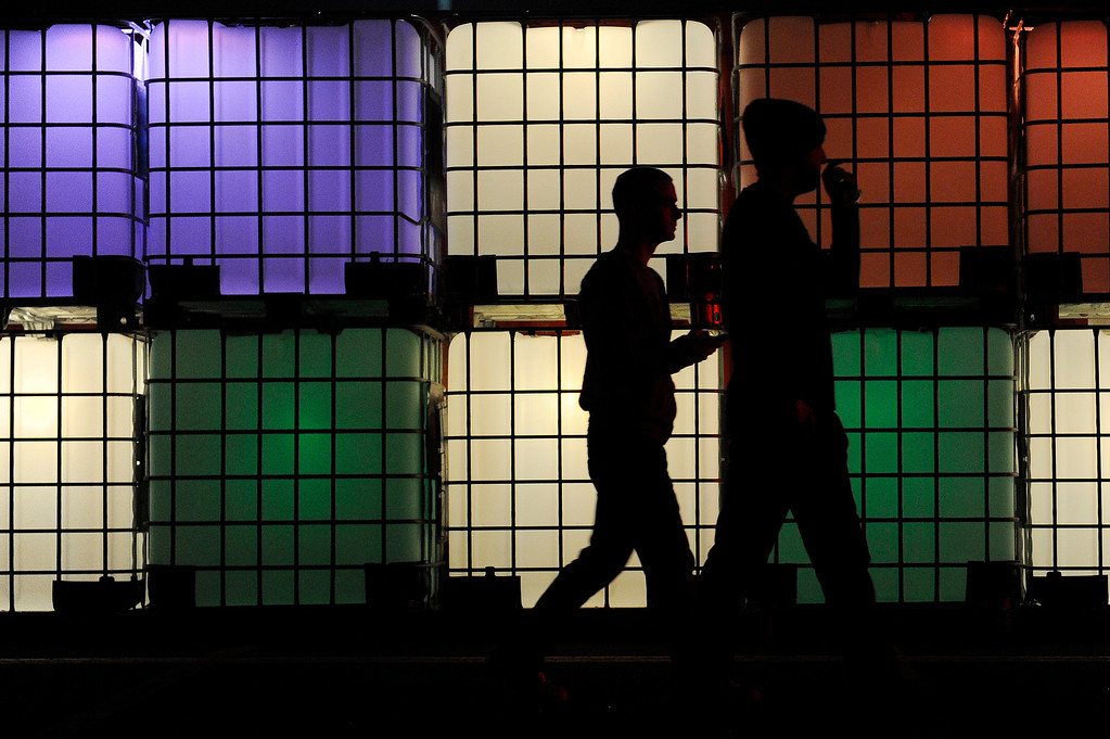 . DENVER, CO - APRIL 4: Fans walk past large light up containers during the Snowball Music Festival at Sports Authority Field at Mile High Stadium on April 4, 2014 in Denver, Colorado. The Snowball Music Festival is celebrating its first year in Denver after spending the previous three years as a mountain based festival. (Photo by Seth McConnell/The Denver Post)