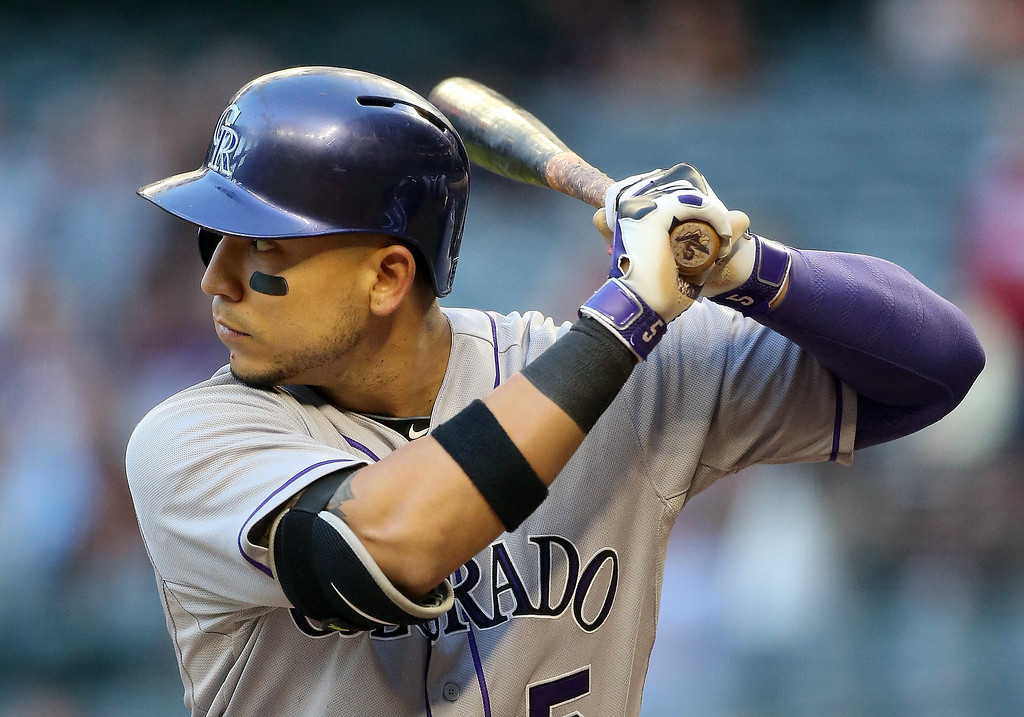 . Carlos Gonzalez #5 of the Colorado Rockies bats against the Arizona Diamondbacks during the first inning of the MLB game at Chase Field on April 30, 2014 in Phoenix, Arizona.  (Photo by Christian Petersen/Getty Images)