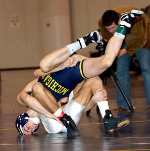 141 lbs. Kellen Russell (MICHIGAN) def J. Jaggers (OHIO ST) by decision 4-3