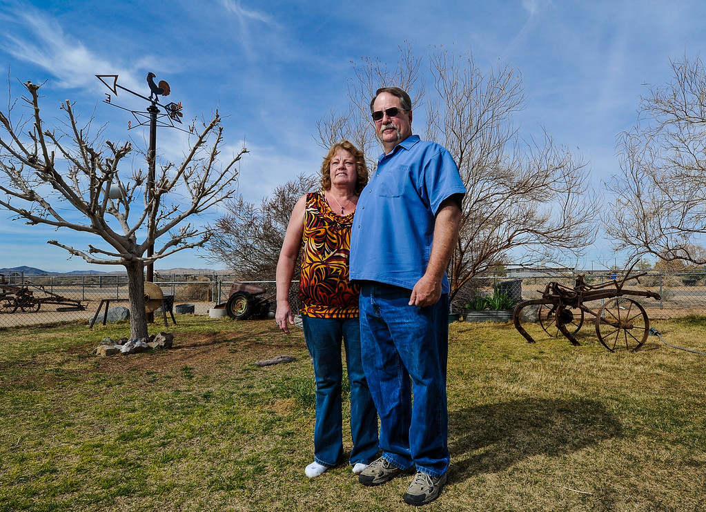 """. \""""We love Hinkley, this is where we grew up. This is our home,\"""" Terry Burns said. Husband and wife Terry and Susie Burns stand in their front yard in Hinkley, Calif. on Monday, March 25, 2013. The Burns grew up in Hinkley and have lived in the town since the 1960s; they have no intention of ever leaving Hinkley. (Rachel Luna / San Bernardino Sun)"""