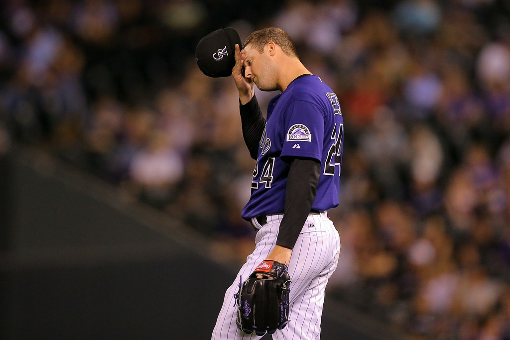 . DENVER, CO - SEPTEMBER 2:  Starting pitcher Jordan Lyles #24 of the Colorado Rockies scratches his head after giving up two home runs during the sixth inning against the San Francisco Giants at Coors Field on September 2, 2014 in Denver, Colorado. (Photo by Justin Edmonds/Getty Images)