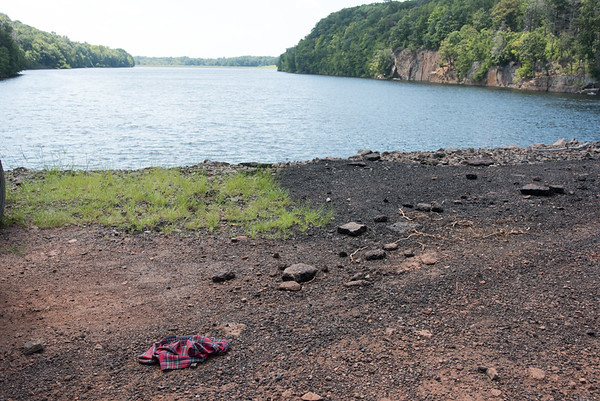 08/29/18 Wesley Bunnell | Staff Boxer underwear lie on the ground at Shuttle Meadow Reservoir on Wednesday afternoon where teens have been caught cliff diving recently.