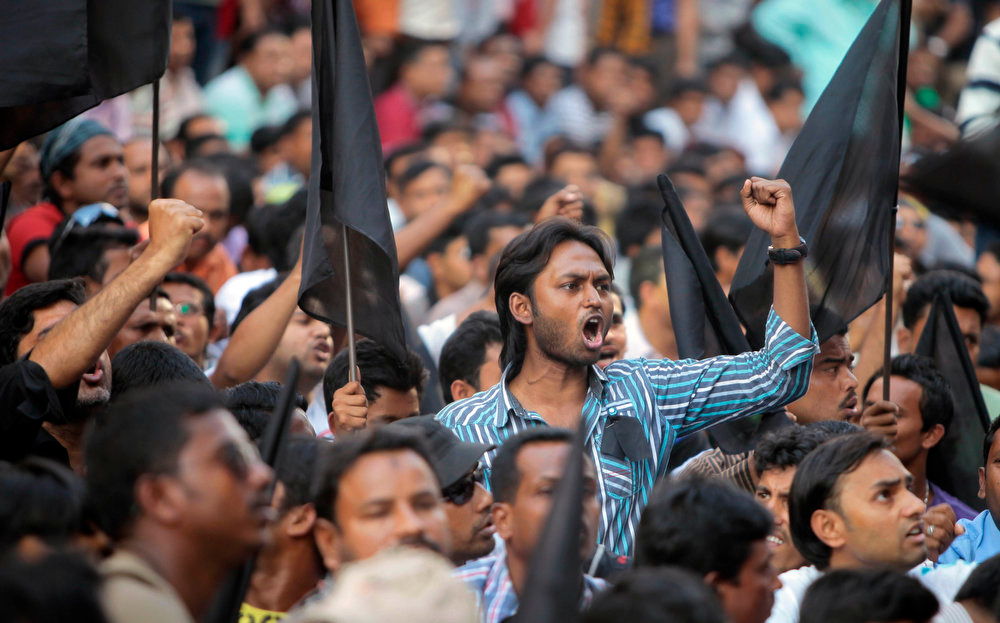 . Opposition Bangladesh Nationalist Party (BNP) activists shout slogans against the government during a protest in Dhaka, Bangladesh, Saturday, March 2, 2013.  (AP Photo/A.M. Ahad)