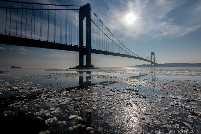 February 22, 2015, New York, NY USA: Ice flows under the Verrazano-Narrows Bridge which connects the boroughs of Brooklyn and Staten Island.