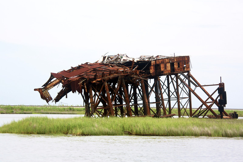 A strange item -- a burned-out off-shore rig abandoned beside the Intercoastal Waterway.