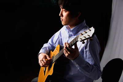 A nice low key shot of a fingerstyle guitarist from UWM's Guitar performance degree program. He sounded amazing