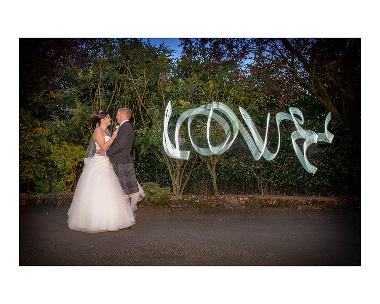 Wedding Photography of Nina & Scott, Grange Manor Hotel, Grangemouth, Falkirk, Photograph is of the Bride & Groom standing in each others arms while Love is written above them