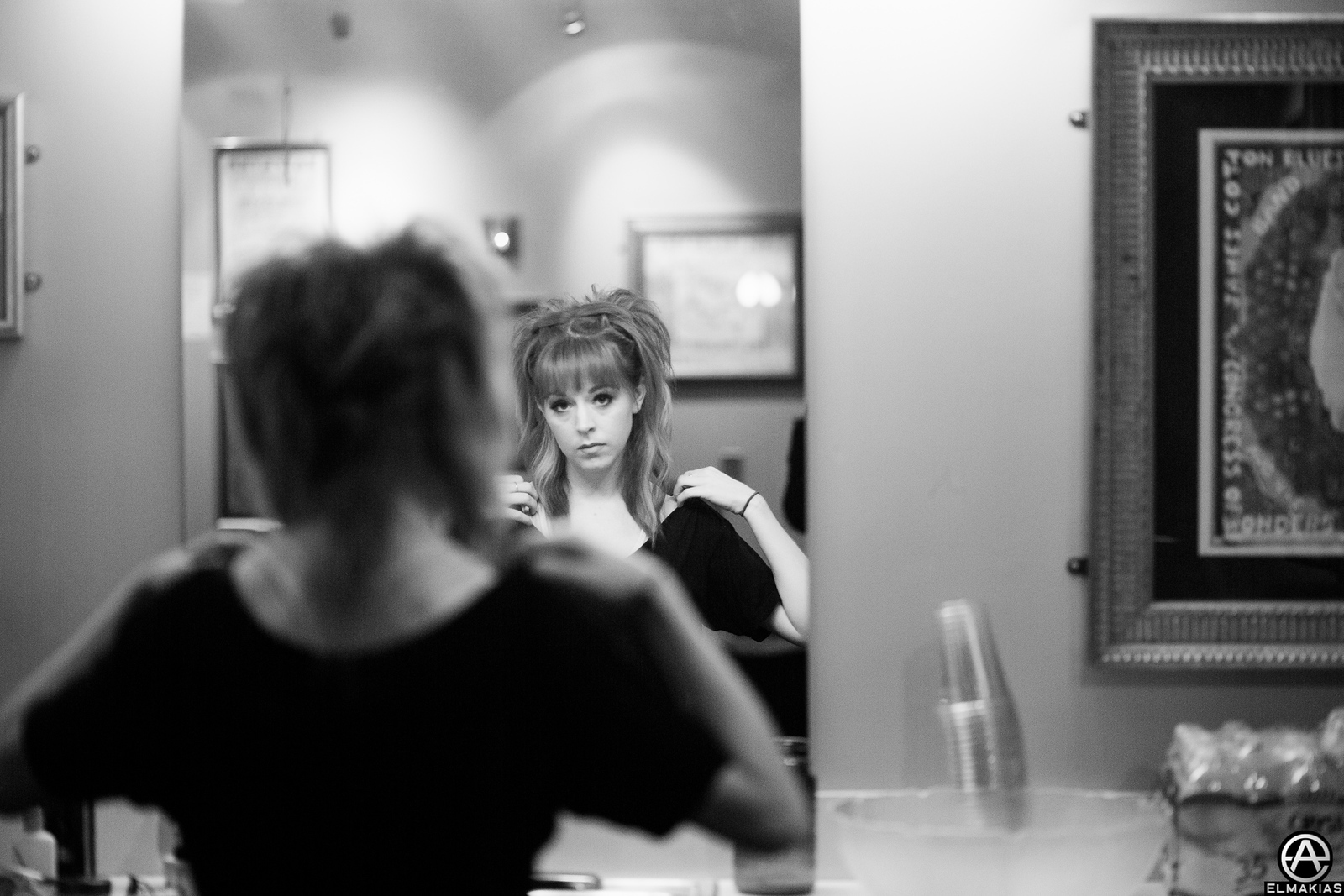 Lindsey getting ready for the show on the Shatter Me Tour by Adam Elmakias