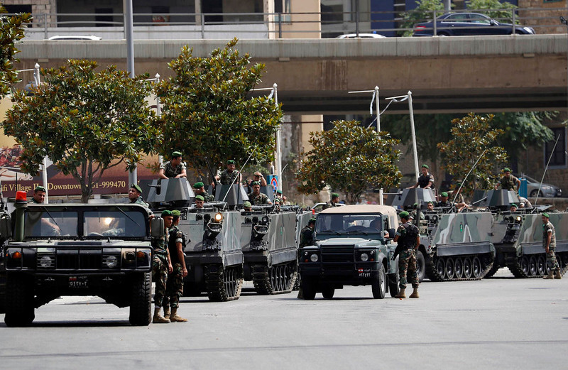 . Lebanese Army soldiers secure a street they have closed off, where anti-Hezbollah activists had earlier held a protest, in Beirut June 9, 2013. A Lebanese protester was killed outside the Iranian embassy in Beirut on Sunday after gunmen from the Iranian-backed Shi\'ite militia Hezbollah opened fire when anti-Hezbollah Shi\'ite demonstrators approached, witnesses and officials said.           REUTERS/Jamal Saidi