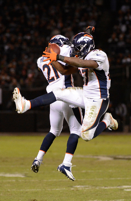 . Denver Broncos running back Knowshon Moreno (27) celebrates his touchdown in the third quarter with Denver Broncos running back Ronnie Hillman (21) Thursday, December 6, 2012 during Thursday Night Football at O.c Coliseum in Oakland  John Leyba, The Denver Post