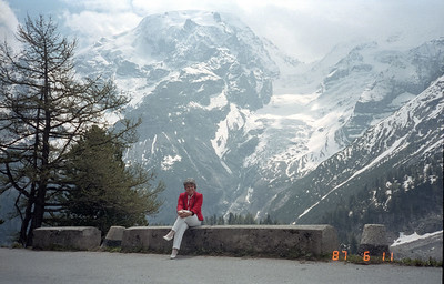 A gorgeous photo of Martha with the impressive, snow-covered mountains of the Swiss/Italian Alps.