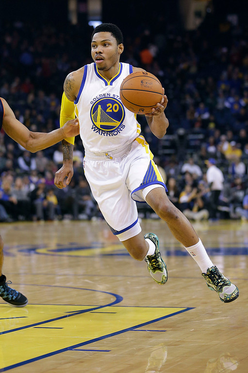 . Golden State Warriors� Kent Bazemore (20) in action against the Charlotte Bobcats during an NBA basketball game in Oakland, Calif., Tuesday, Feb. 4, 2014. (AP Photo/Tony Avelar)