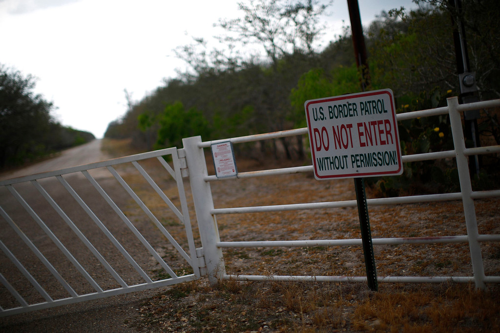 ". A sign is seen on the gate of a ranch in Falfurrias, Texas April 2, 2013. Brooks County has become an epicentre for illegal immigrant deaths in Texas. In 2012, sheriff\'s deputies found 129 bodies there, six times the number recorded in 2010. Most of those who died succumbed to the punishing heat and rough terrain that comprise the ranch lands of south Texas. Many migrants spend a few days in a ""stash house\"", such as the Casa del Migrante, in Reynosa, Mexico, and many are ignorant of the treacherous journey ahead. Picture taken April 2, 2013. REUTERS/Eric Thayer"