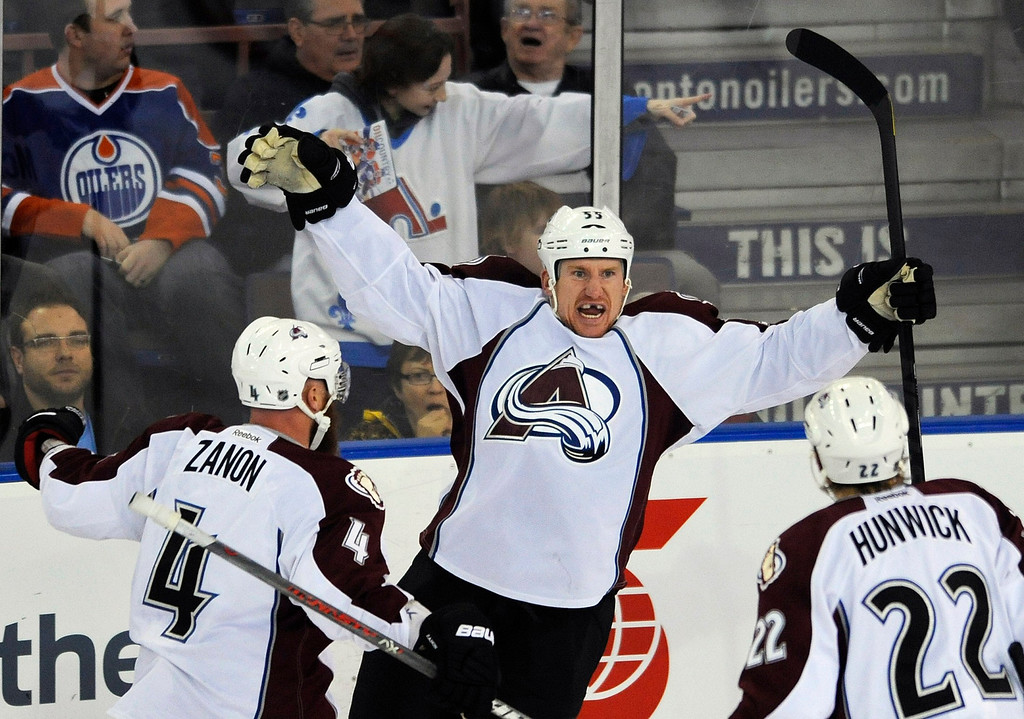 . Colorado Avalanche\'s Cody McLeod (C) celebrates his goal with teammates Greg Zanon (L) and Matt Hunwick during the first period of their NHL hockey game against the Edmonton Oilers in Edmonton February 16, 2013.  REUTERS/Dan Riedlhuber