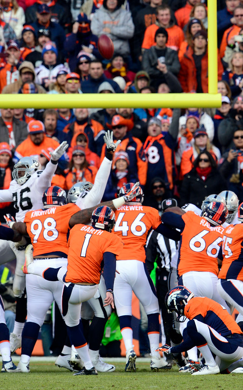 . DENVER, CO - DECEMBER 28: Connor Barth (1) of the Denver Broncos drives one through the goal posts making the score 17 to 7 in the second quarter.  The Denver Broncos played the Oakland Raiders at Sports Authority Field at Mile High in Denver on December, 28 2014. (Photo by Joe Amon/The Denver Post)