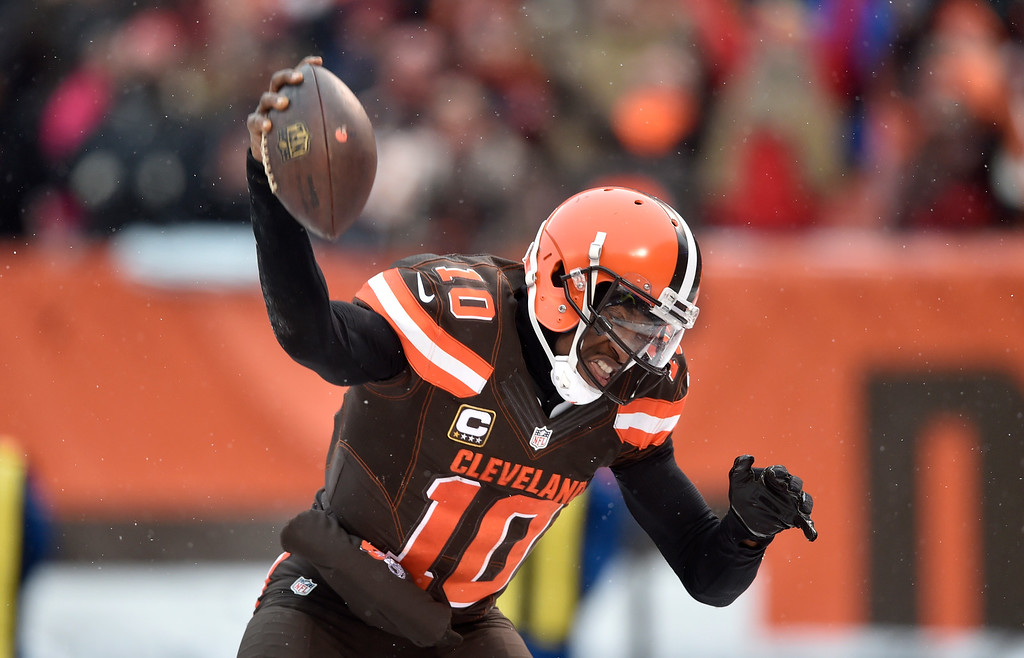 . Cleveland Browns quarterback Robert Griffin III (10) celebrates a 1-yard rushing touchdown in the second half of an NFL football game against the Cincinnati Bengals, Sunday, Dec. 11, 2016, in Cleveland. (AP Photo/David Richard)