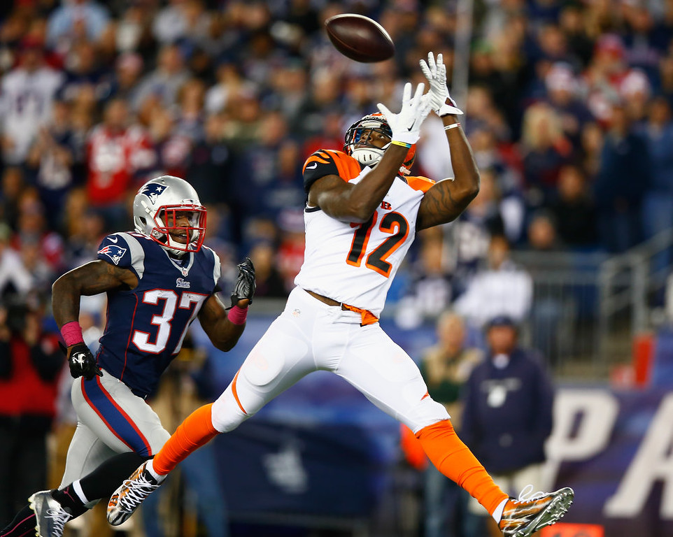 . Mohamad Sanu #12 of the Cincinnati Bengals catches a touchdown pass as Alfonzo Dennard #37 of the New England Patriots defends during the third quarter  at Gillette Stadium on October 5, 2014 in Foxboro, Massachusetts.  (Photo by Jared Wickerham/Getty Images)