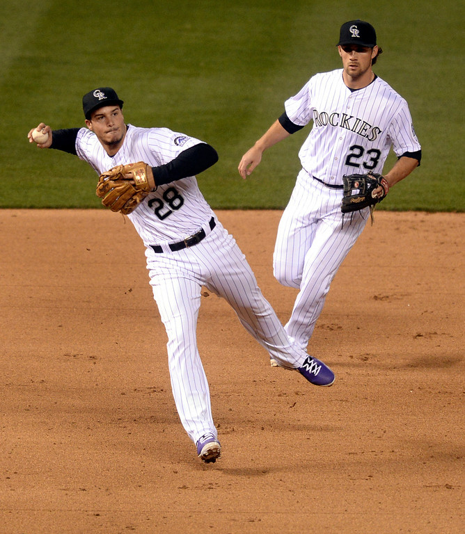 . DENVER, CO - APRIL 5:  Colorado 3B Nolan Arenado (28) threw to first attempting to retire Arizona batter Chris Owings in the ninth inning. Owings was safe. The Colorado Rockies defeated the Arizona Diamondbacks 9-4 Saturday night, April 5, 2014 in Denver. (Photo by Karl Gehring/The Denver Post)