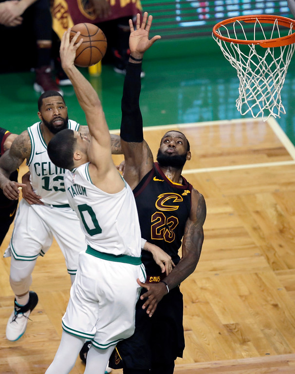 . Boston Celtics forward Jayson Tatum dunks against Cleveland Cavaliers forward LeBron James, right, during the second half in Game 7 of the NBA basketball Eastern Conference finals, Sunday, May 27, 2018, in Boston. (AP Photo/Charles Krupa)