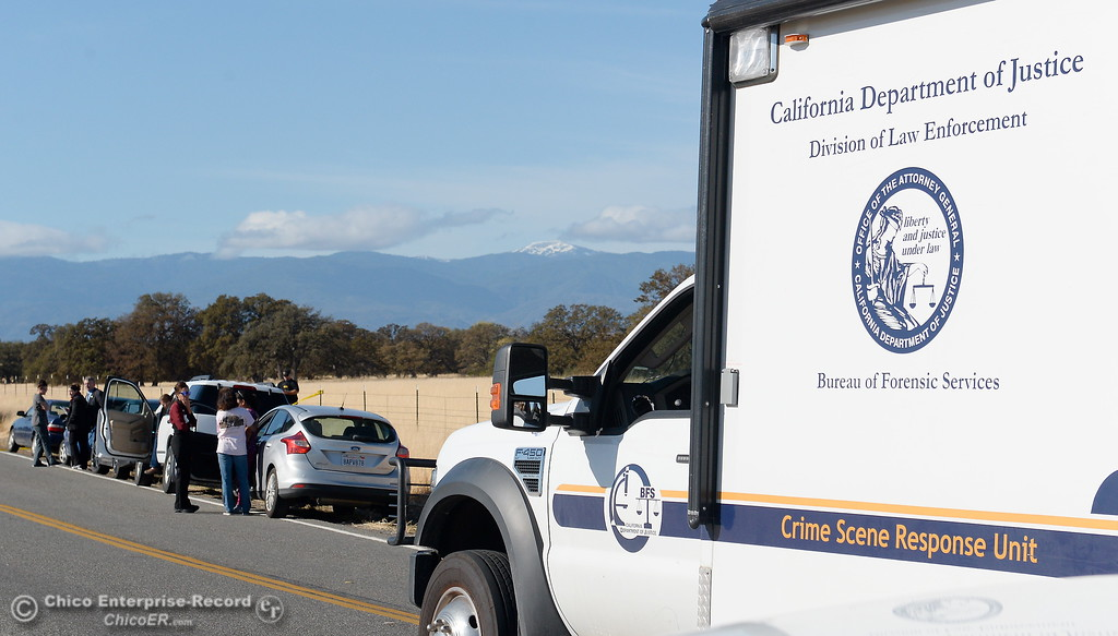 . A California Department of Justice vehicle arrives while Rancho Tehama Road is closed to traffic at Paskenta Road, where worried residents and reporters lined the road Tues. Nov. 14, 2017.  (Bill Husa -- Enterprise-Record)