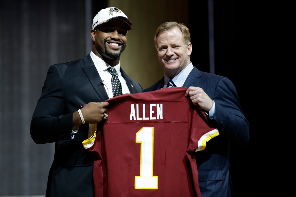 . Alabama\'s Jonathan Allen, left, poses with NFL commissioner Roger Goodell after being selected by the Washington Redskins during the first round of the 2017 NFL football draft, Thursday, April 27, 2017, in Philadelphia. (AP Photo/Matt Rourke)
