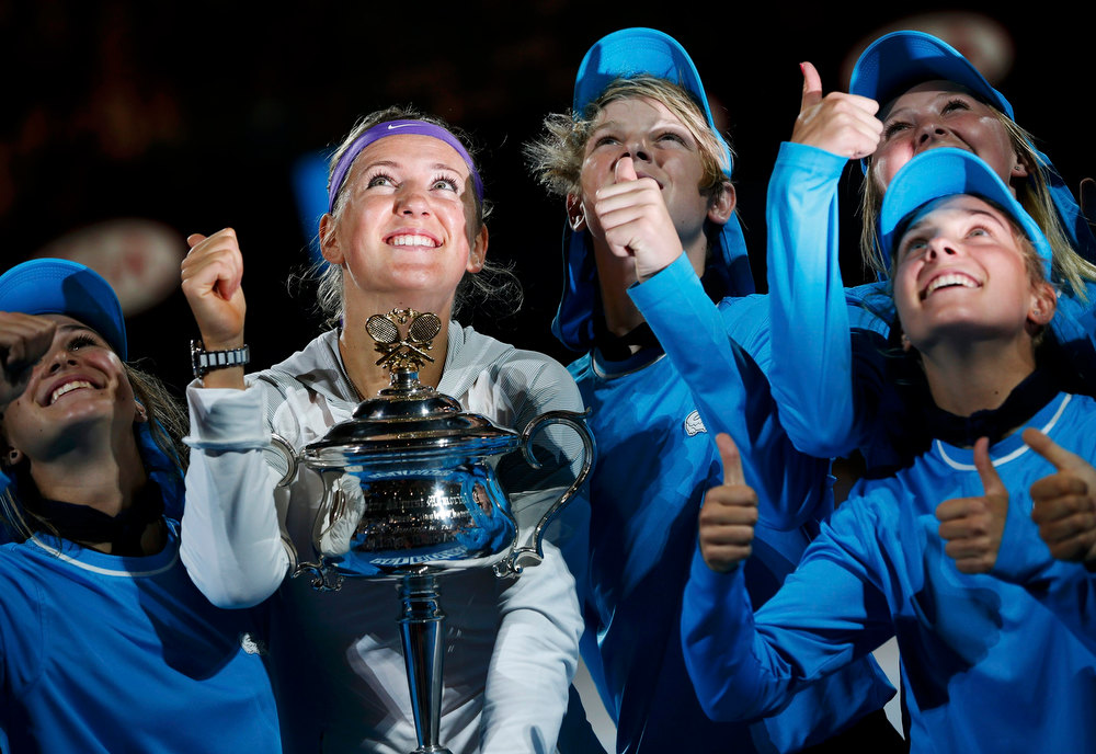 . Victoria Azarenka of Belarus poses with The Daphne Akhurst Memorial Cup after defeating Li Na of China in their women\'s singles final match at the Australian Open tennis tournament in Melbourne, January 26, 2013.   REUTERS/Damir Sagolj
