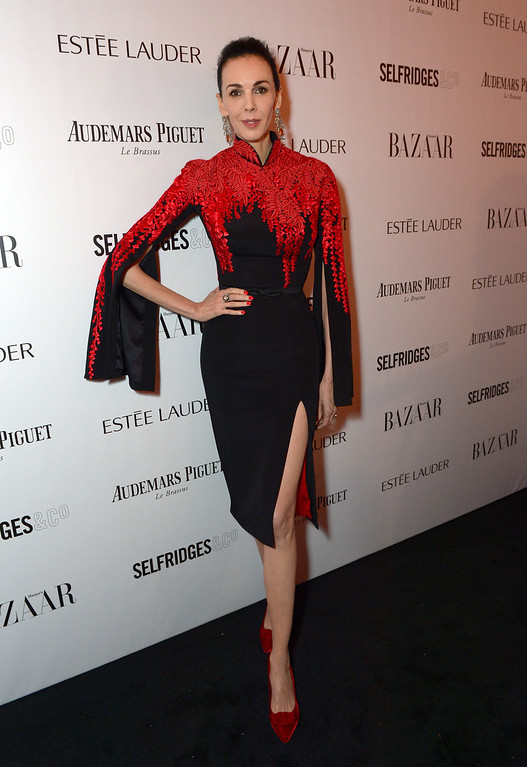 . L\'Wren Scott attends Harper\'s Bazaar Women of the Year Awards 2013 at Claridge\'s Hotel on Tuesday, Nov. 5, 2013, in London. (Photo by Jon Furniss/Invision for Harper\'s Bazaar/AP)