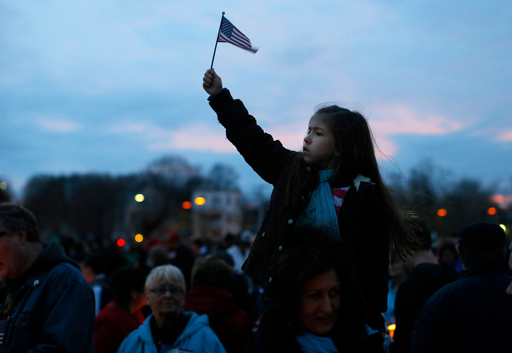 ". A girl holds up a U.S. flag during a candlelight vigil in the Dorchester neighborhood of Boston, Massachusetts April 16, 2013 where eight-year-old Boston Marathon bombing victim Martin Richard lived. A Little League baseball player, Martin lived in the blue Victorian house in working-class Dorchester - a Boston neighborhood dotted with ""Kids at Play\"" traffic signs and budding trees - with his parents Bill and Denise, sister Jane, 7, and brother Henry, 10. Bill Richard told the world in an email on Tuesday that his son had been killed when bombs exploded at the marathon finish line. Martin\'s mother and sister were seriously injured.         REUTERS/Brian Snyder"