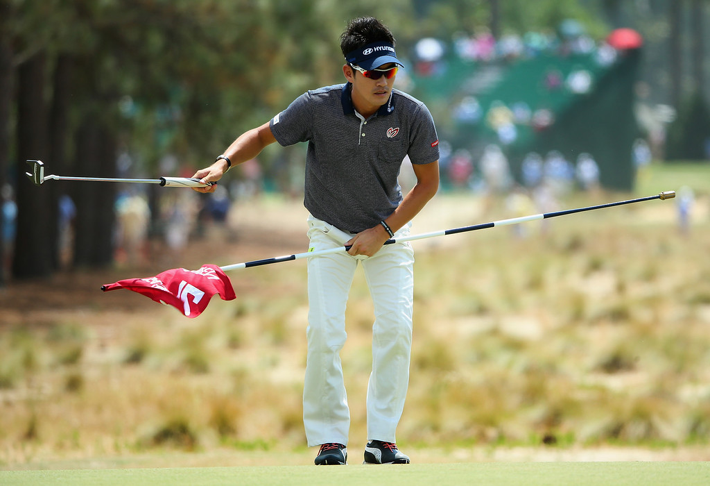 . Hyung Sung Kim of Korea reacts to his putt on the 12th  hole during the first round of the 114th U.S. Open at Pinehurst Resort & Country Club, Course No. 2 on June 12, 2014 in Pinehurst, North Carolina.  (Photo by Andrew Redington/Getty Images)