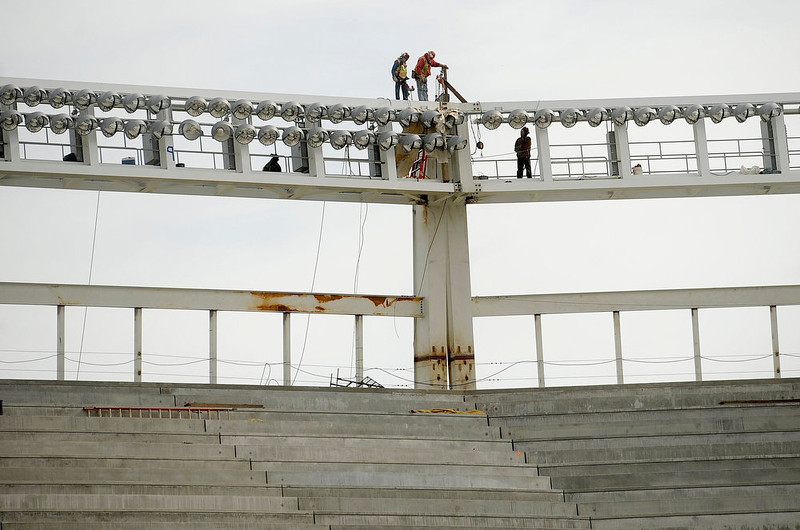 . Workers check construction near a lighting array atop Santa Clara Stadium, the future home of the NFL\'s San Francisco 49\'ers, in Santa Clara, California March 6, 2013. The stadium is scheduled to open in time for the 2014 NFL season.  REUTERS/Noah Berger