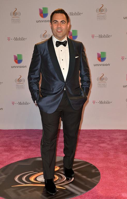 ". Enrique Santos arrives at the 25th Anniversary Of Univision\'s \""Premio Lo Nuestro A La Musica Latina\"" on February 21, 2013 in Miami, Florida.  (Photo by Gustavo Caballero/Getty Images for Univision)"
