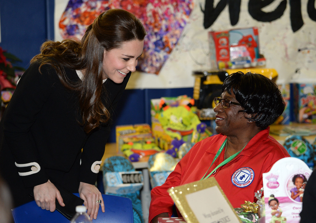 . Catherine, Duchess of Cambridge helps to wrap Christmas presents during a visit to the Northside Center for Child Development on December 8, 2014 in New York City. The royal couple are on an official three-day visit to New York with Prince William also due to meet President Barack Obama in Washington D.C today.  (Photo by Mark Stewart - Pool/Getty Images)