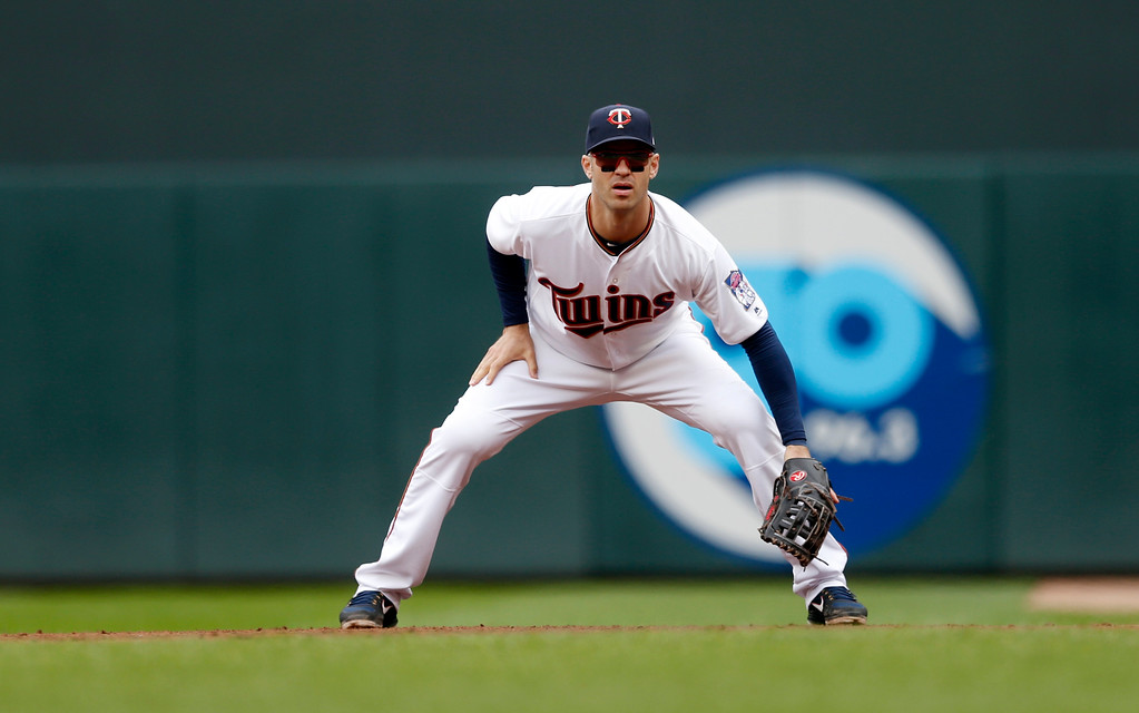 . Minnesota Twins\' Joe Mauer plays first base against the Cleveland Indians in the third inning of a baseball game Thursday, April 20, 2017, in Minneapolis. (AP Photo/Jim Mone)