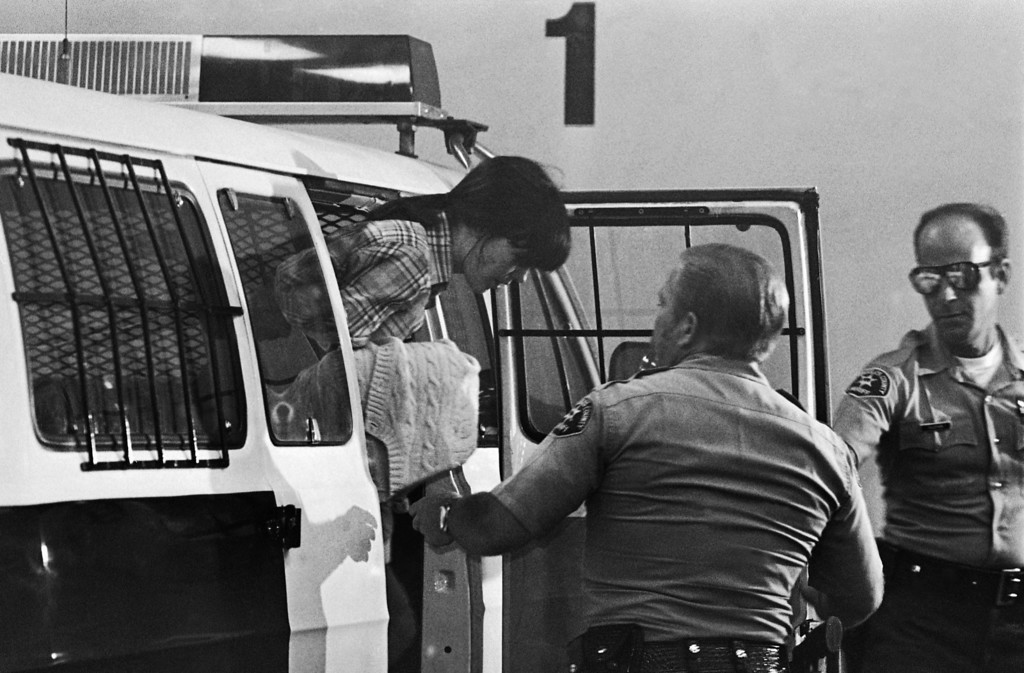 . Leslie Van Houten leaves the sheriff\'s van that brought her to the Criminal Courts Building in Los Angeles, July 22, 1977 where the six-man, six-woman jury is deliberating charges against her in the murder of Leno and Rosemary LaBianca in August of 1969. The jury, in its 12th day of deliberations, returned to court to ask for definitions involving the question of diminished mental capacity. (AP Photo)