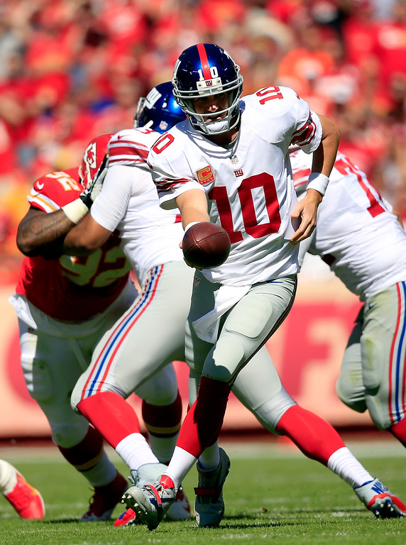 . KANSAS CITY, MO - SEPTEMBER 29:  Quarterback Eli Manning #10 of the New York Giants in action during the game against the Kansas City Chiefs at Arrowhead Stadium on September 29, 2013 in Kansas City, Missouri.  (Photo by Jamie Squire/Getty Images)