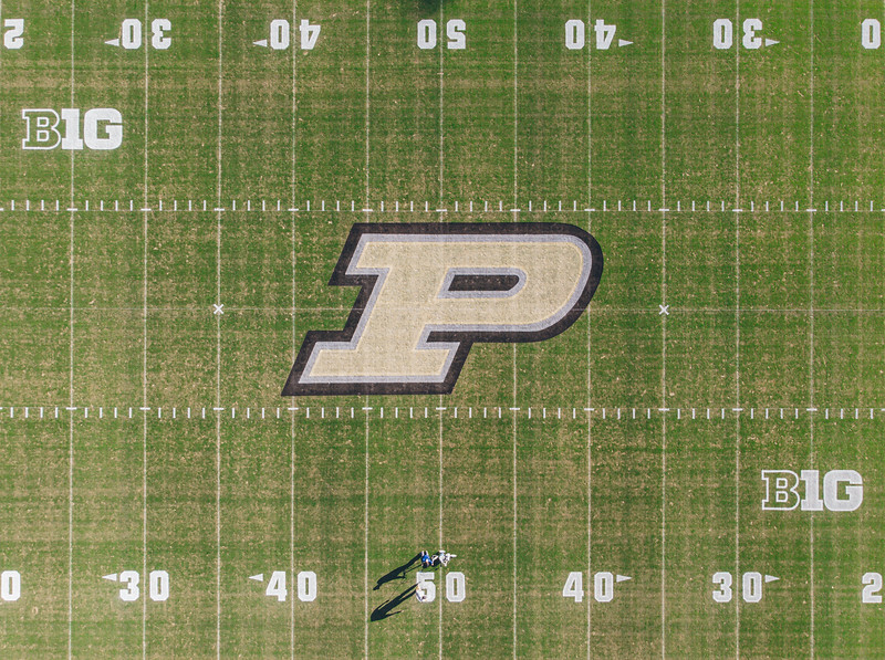 Numbers are painted on the field at Ross Ade Stadium before a game against Illinois.