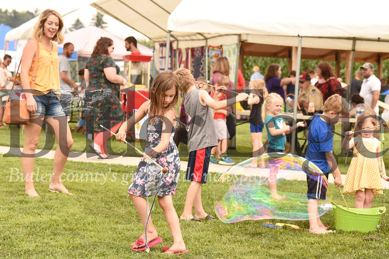 Lana Madia, 6, of Wexford makes a giant bubble at Penn Township Community Day. Seb Foltz/Butler Eagle