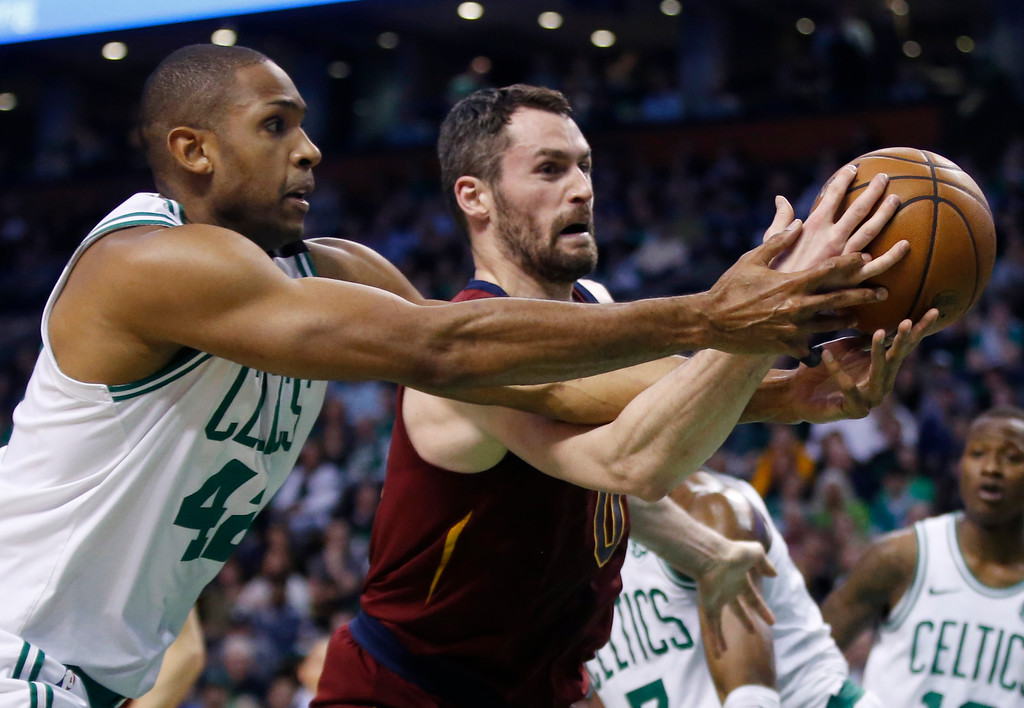 . Boston Celtics forward Al Horford (42) and Cleveland Cavaliers center Kevin Love compete for control of the ball during the first quarter of Game 1 of the NBA basketball Eastern Conference Finals, Sunday, May 13, 2018, in Boston. (AP Photo/Michael Dwyer)