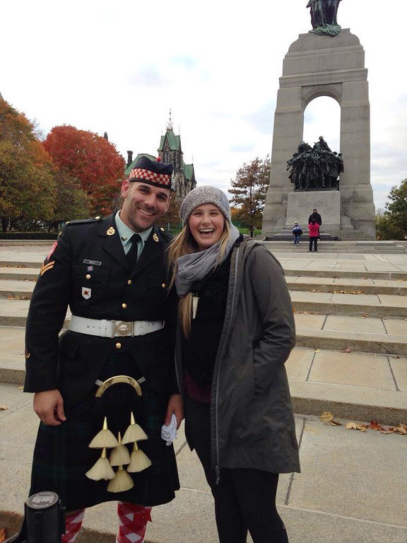 . In this photo provided by Megan Underwood, Steph Winsor, right, poses for a photo with Cpl. Nathan Cirillo, on Sunday, Oct. 19, 2014, in front of the National War Memorial, in Ottawa, Ontario. Cirillo was killed by a gunman on Wednesday, Oct. 22, while he was on post at the National War Memorial. (AP Photo/Megan Underwood)